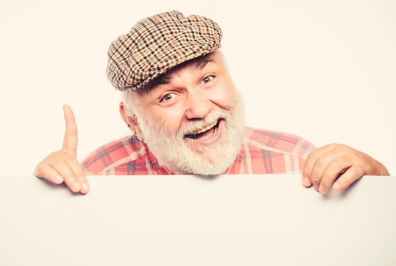 Great odea. Senior bearded man place announcement on banner. happy mature man in retro hat. Advertisement. job search royalty free stock photo