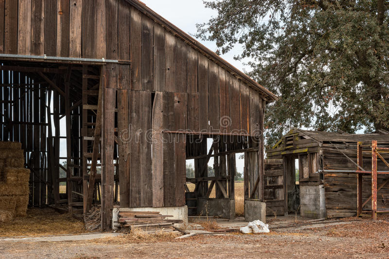 Great old barn. Working barn shows years of wear and tear royalty free stock images