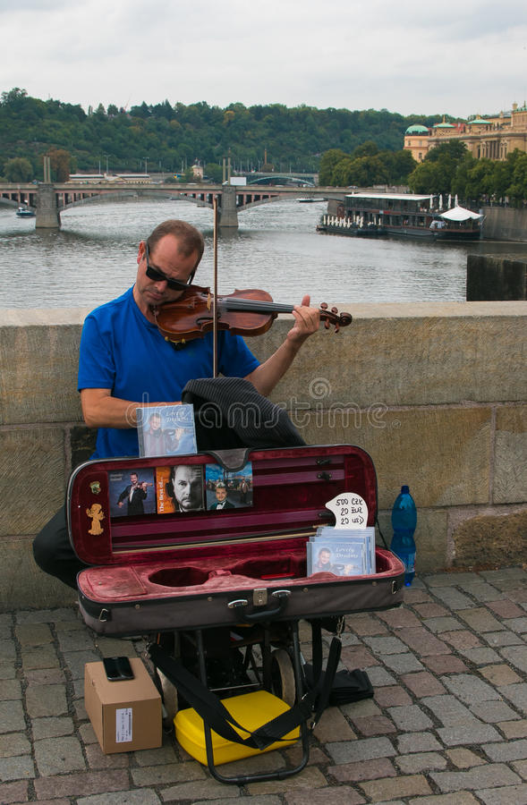 Great performance of street musician of violinist on Charles Bridge, Prague stock image