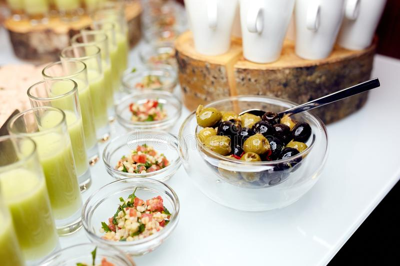 Interesting dishes and olives in a plates. Great photo of interesting dishes in glass plates and olives stock photography