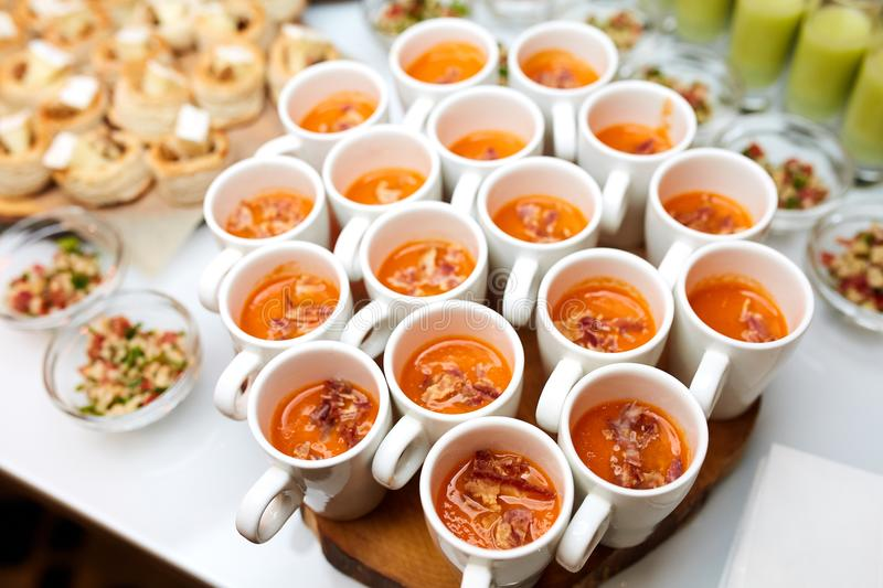 Interesting dishes in a plates and cups. Great photo of interesting dishes in a glass plates and orange dish in a cups stock photography