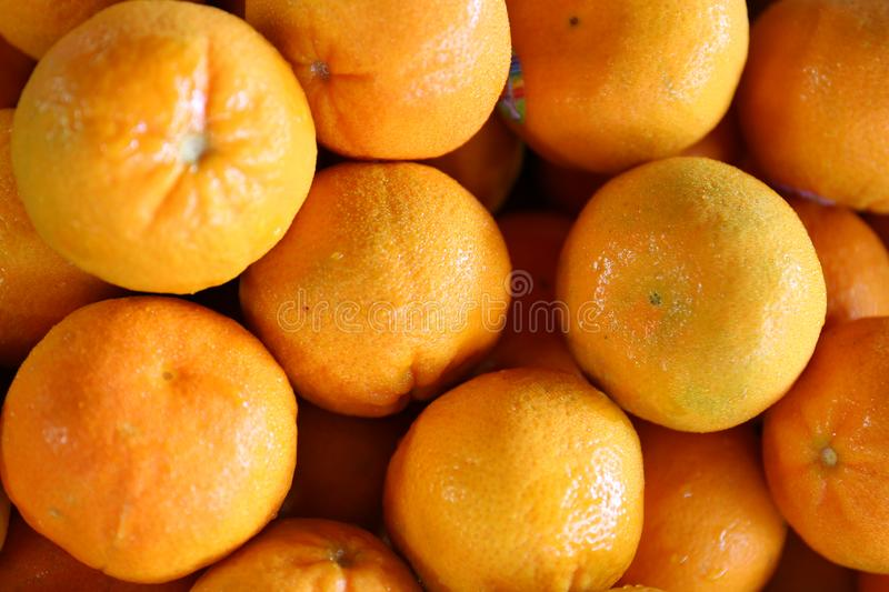 Citrus Oranges on Display Closeup with Macro Lens. A great photo of oranges shot with a macro lens.  A great background texture for graphic artists, web stock photo