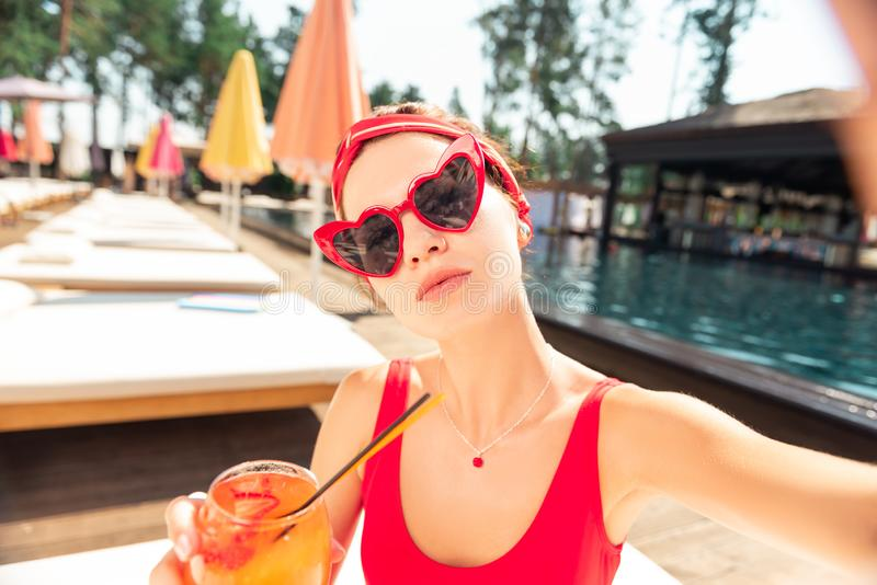 Selfie of a beautiful nice young woman. Great photo. Selfie of a beautiful nice woman taken while resting near the swimming pool royalty free stock photos