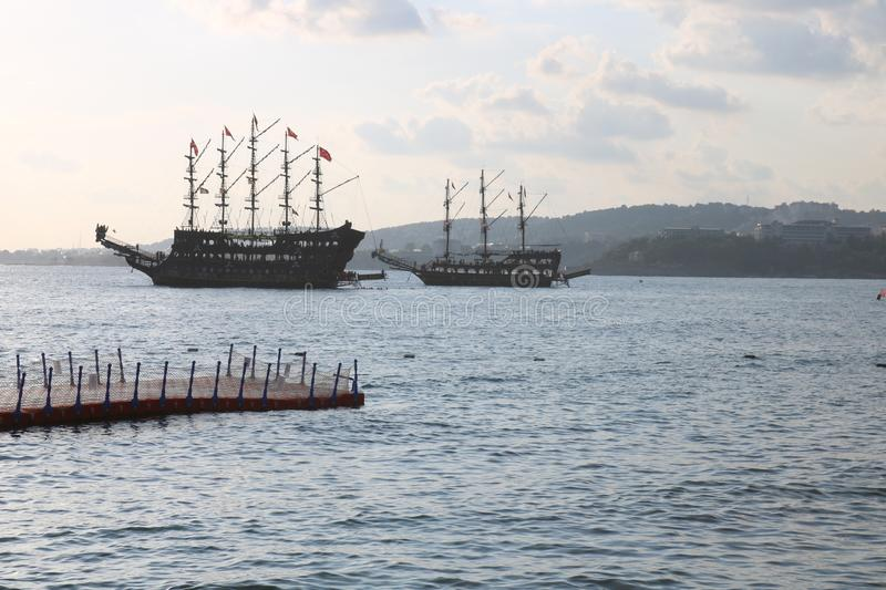 Great pirat ship in sea, Turkey. Sunset and old ship. royalty free stock photos