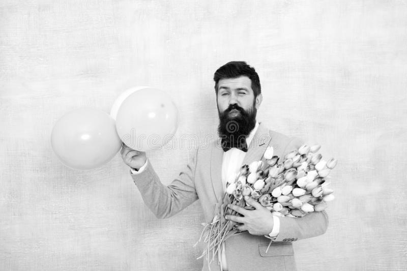Great pleasure. love date with flowers. Happy Birthday. spring bouquet. 8 of march. womens day. Formal mature. Businessman bearded man in bow tie with tulip royalty free stock photo