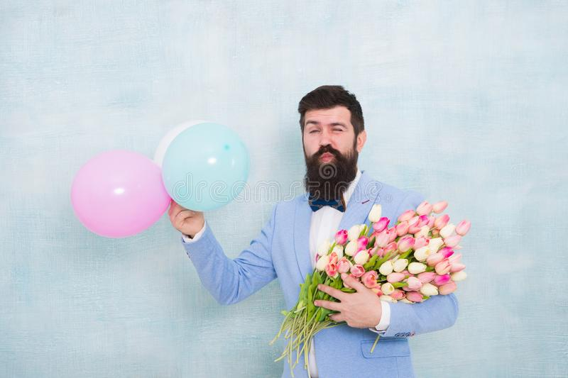 Great pleasure. love date with flowers. Happy Birthday. spring bouquet. 8 of march. womens day. Formal mature. Businessman bearded man in bow tie with tulip stock photo