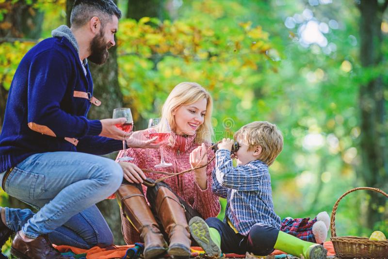 Great pleasure. Mother, father love their little boy child. Happy son with parents relax in autumn forest. Fall weather. Wine drinking. Spring mood. Happy royalty free stock photo