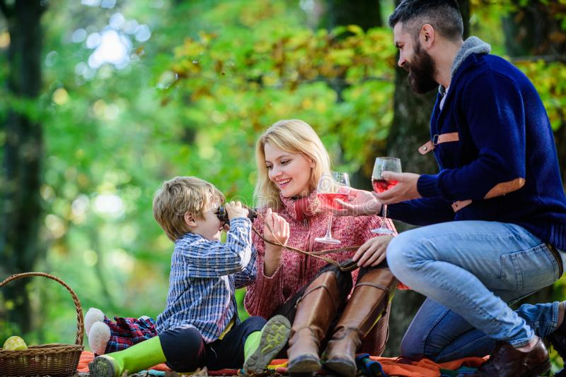 Great pleasure. Mother, father love their little boy child. Happy son with parents relax in autumn forest. Fall weather. Wine drinking. Spring mood. Happy stock photos