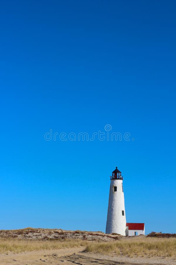 Great Point Light Lighthouse Nantucket with Blue Sky, Beach Grass and Dunes royalty free stock photo