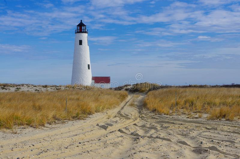 Great Point Lighthouse with blue skies, Nantucket, Massachusetts royalty free stock image