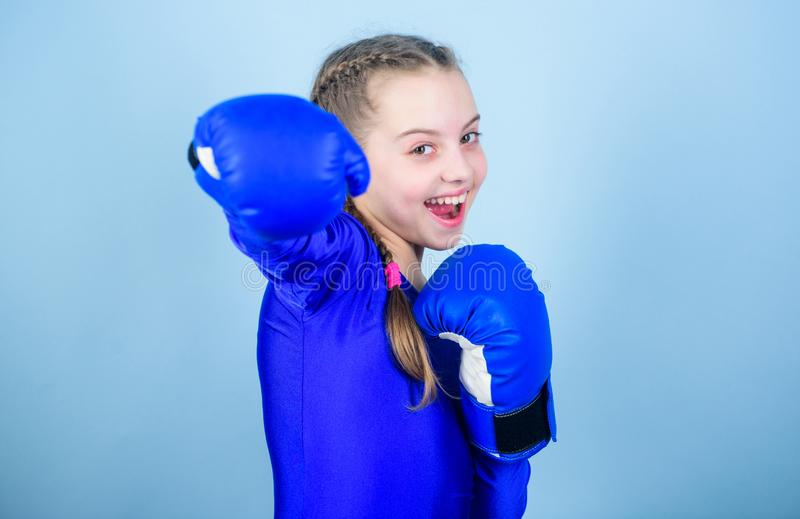With great power comes great responsibility. Boxer child in boxing gloves. Girl cute boxer on blue background. Rise of. Woman boxers. Female boxer change royalty free stock photo