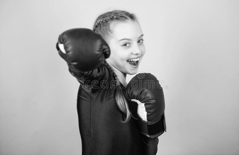 With great power comes great responsibility. Boxer child in boxing gloves. Girl cute boxer on blue background. Rise of. Woman boxers. Female boxer change royalty free stock images
