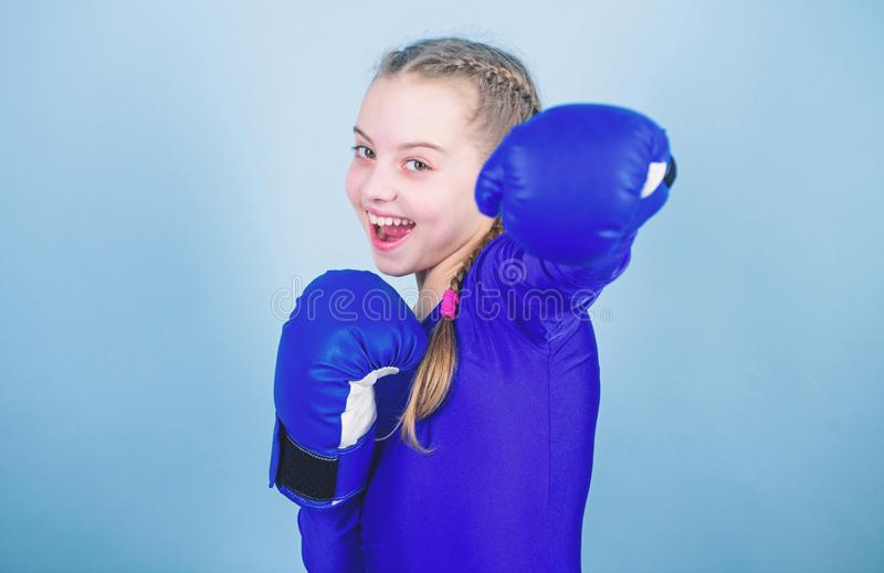 With great power comes great responsibility. Boxer child in boxing gloves. Girl cute boxer on blue background. Rise of. Woman boxers. Female boxer change stock photography