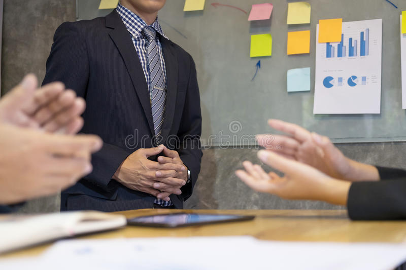 Great presentation! Group of business people in smart casual wea stock images