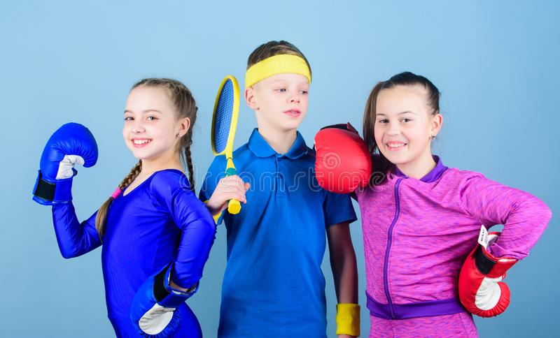 Great progress. Happy children in boxing gloves with tennis racket and ball. Fitness energy health. punching knockout. Team sport success. workout of small royalty free stock photos