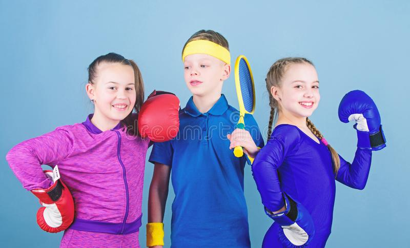 Great progress. Happy children in boxing gloves with tennis racket and ball. Fitness energy health. punching knockout. Team sport success. workout of small stock image