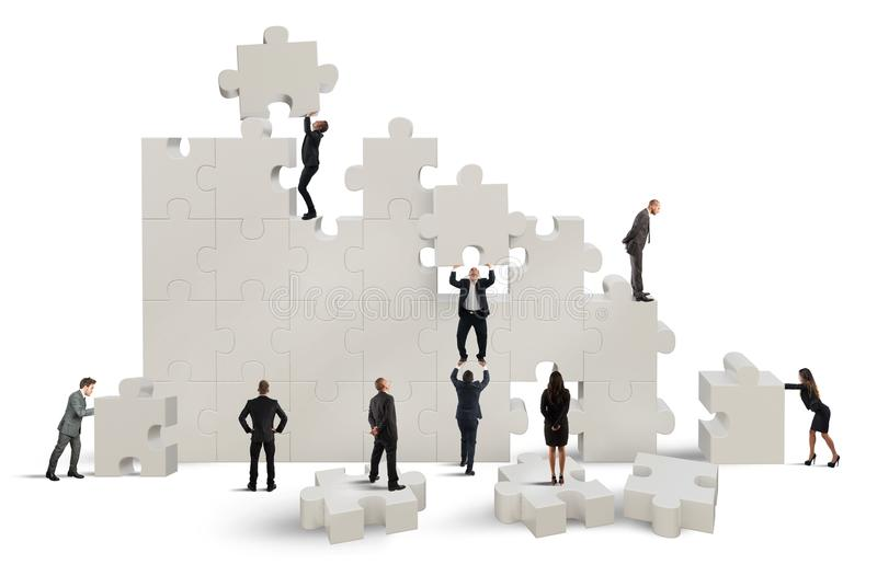 Great puzzle. Business team working to build a puzzle royalty free illustration