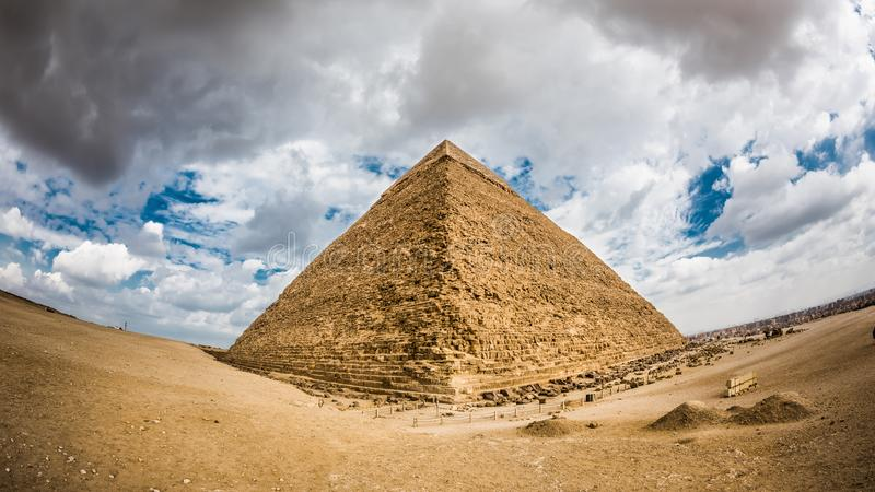 The great Pyramid of Giza. Great Pyramid of Giza, Egypt, photo taken with a fisheye lens on a cloudy december day stock photo