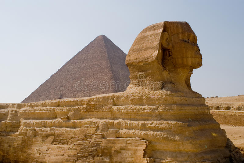 The Great pyramid and The Great Sphinx. This is the great pyramid of giza and the the Great Sphinx of Giza, located in egypt royalty free stock photography