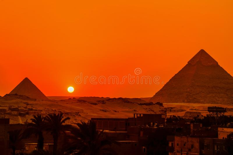 Great Pyramid sunset. The lingering light of the setting sunWhen the sun begins to set behind the Pyramid, the lingering light of the setting sun fills the sky royalty free stock photography