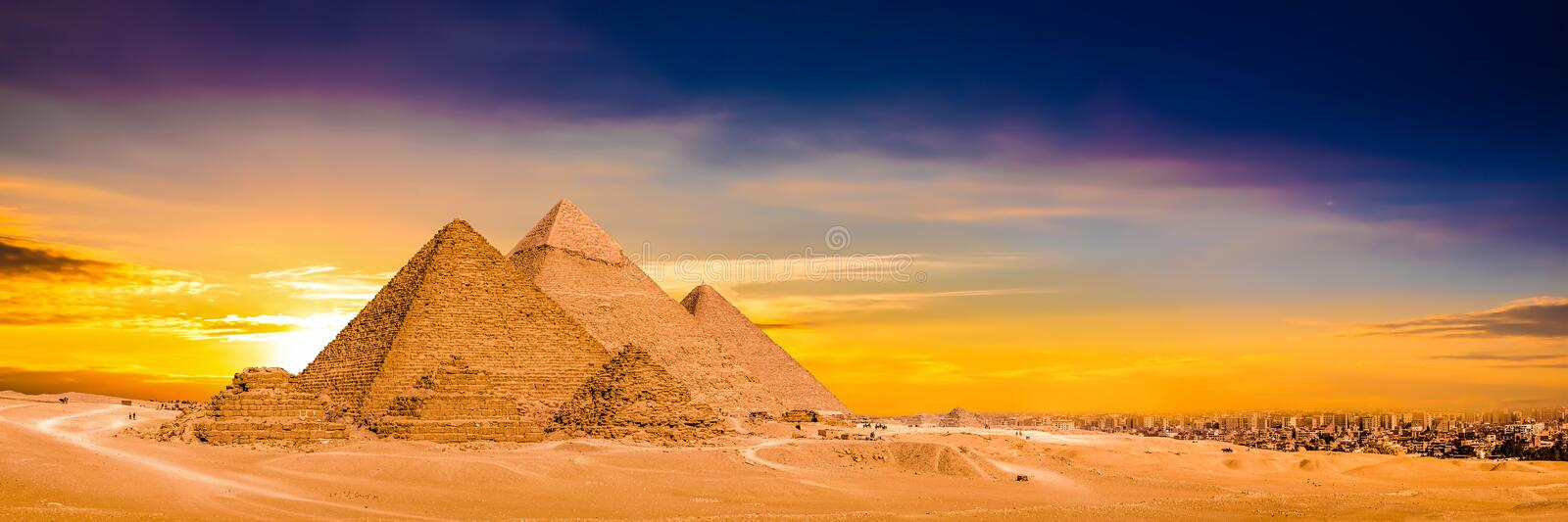 Great Pyramids of Giza, Egypt. Panorama of the Great Pyramids of Giza at sunset, Egypt royalty free stock images