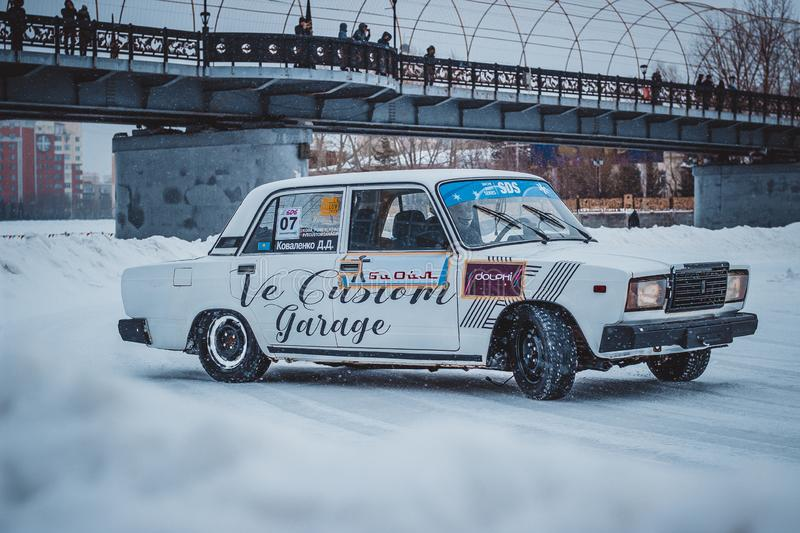 Perfect racing cars on the snow royalty free stock photos