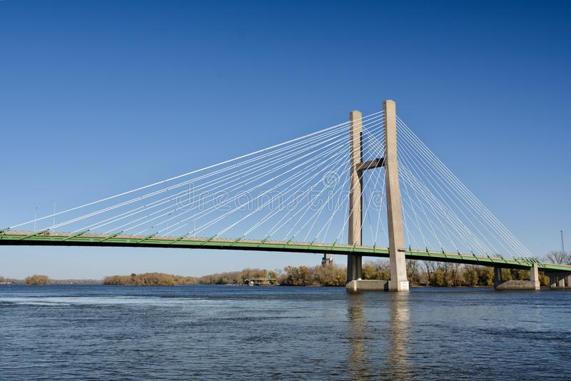 Great River Bridge. This is a Fall picture of the Great River Bridge over the Mississippi River that connects Burlington, Iowa and Gulf Port, Illinois. This a a stock photography