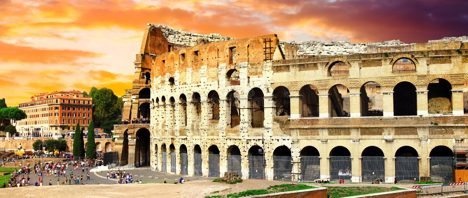 Great Rome, panoramic view with Colosseo over sunset stock images