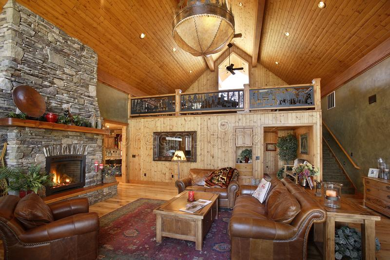 Log Cabin on an Idaho lake. The great room in a rustic log cabin, with with a stone fireplace, and rustic western decor royalty free stock photography