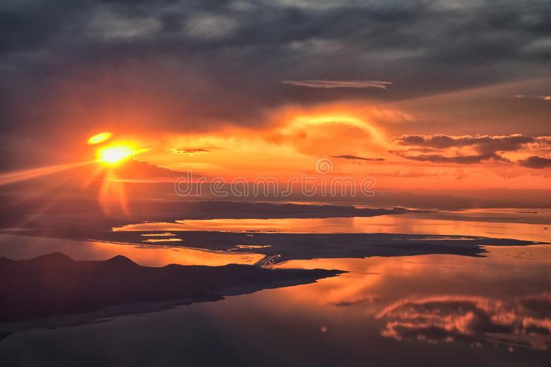 Great Salt Lake Sunset Aerial view from airplane in Wasatch Rocky Mountain Range, sweeping cloudscape and landscape Utah stock image