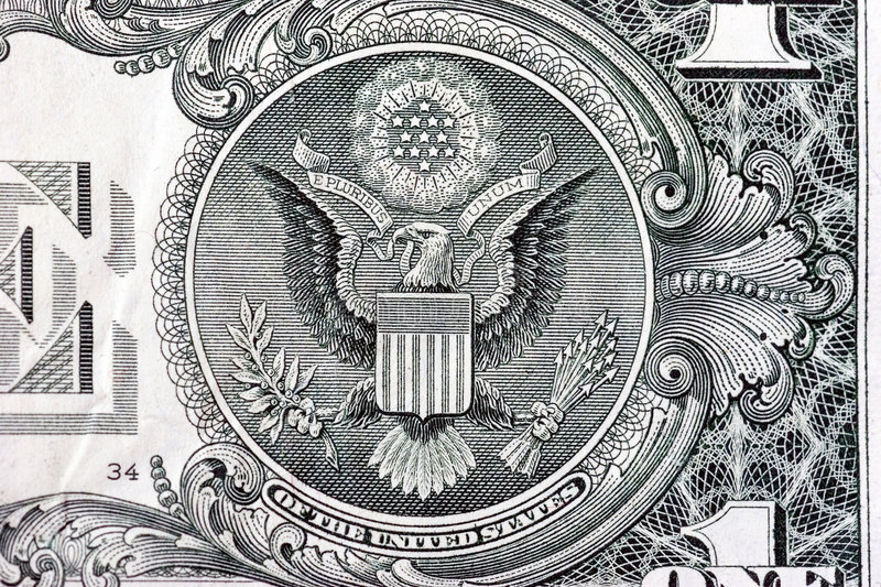 The Great Seal on back of one dollar bill. A one dollar bill close up, showing the eagle on the great seal of the United States stock photo