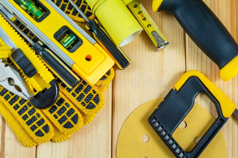 Great set of tools for the Builder on a wooden background with a place for advertising. Great set of tools for the Builder on a natural wooden background with stock images