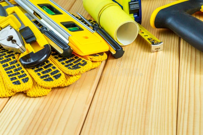 Great set of tools for the Builder on a wooden background with a place for advertising. Great set of tools for the Builder on a natural wooden background with royalty free stock image
