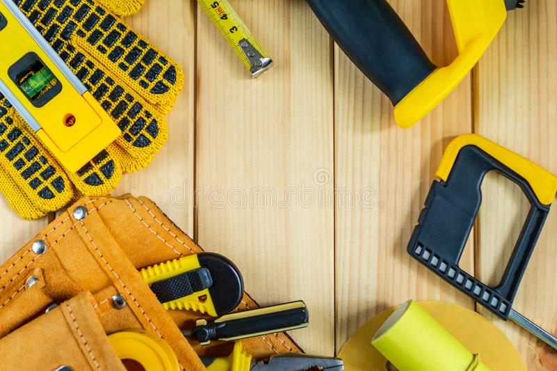 Great set of tools for the Builder on a wooden background with a place for advertising. Great set of tools for the Builder on a natural wooden background with stock photo