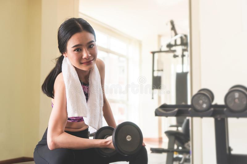 Great shaped woman working out alone in fitness stock photography