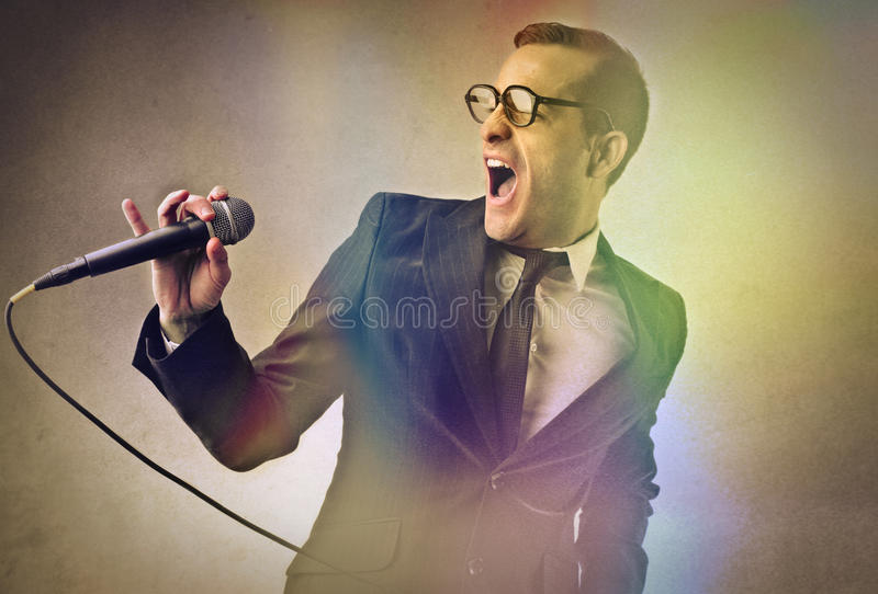 A great singer. Performing in front of his audience royalty free stock images