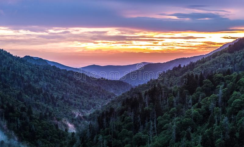 Great Smoky Mountain Sunset Background. Great Smoky Mountain sunset panorama over the many layers and ridges of the beautiful Appalachian Mountains of Tennessee stock photography