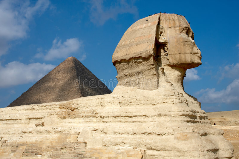 Great Sphinx on the background of pyramid in Egypt stock image