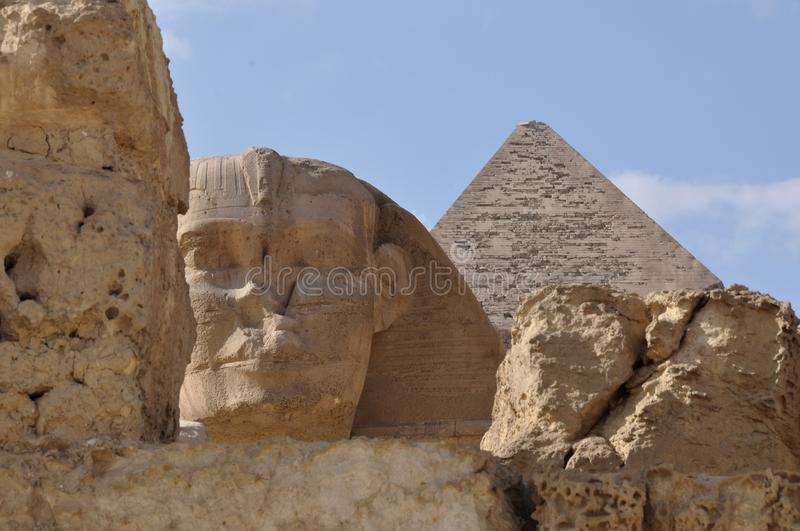 The Great Sphinx of Egypt and The Great Pyramid detail. As seen through the old Stone Gate royalty free stock image