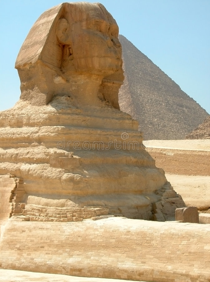Great Sphinx and Khufu Pyramid, Giza, Egypt. Great Sphinx with Great Pyramid in background. Giza, Egypt royalty free stock photos