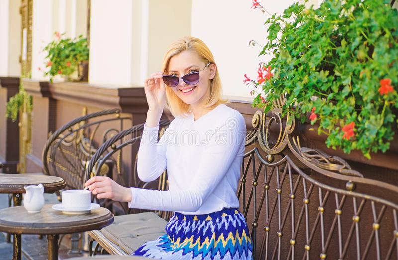 Great start of day. Mug of good coffee in morning gives me energy charge. Woman elegant happy face have coffee cafe. Terrace outdoors. Girl drink coffee every stock images