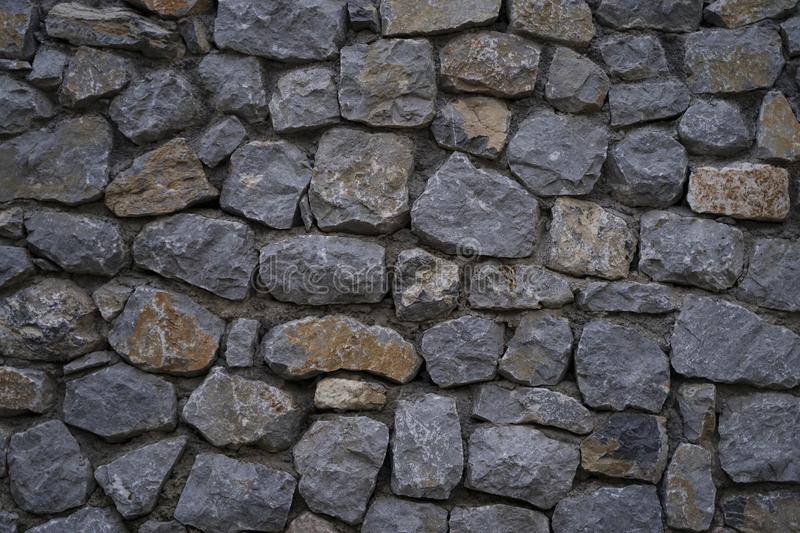Great stone wall good for texture backgrounds. Wallpapers. Old city stones stock photography
