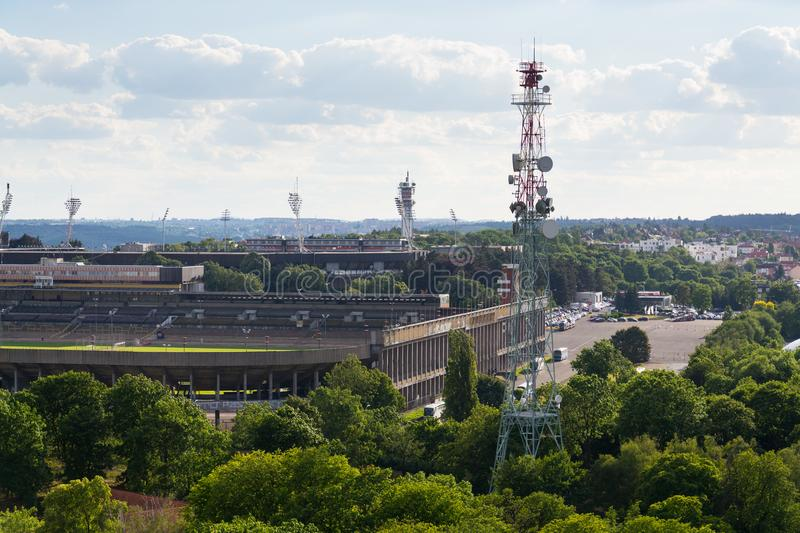 The Great Strahov Stadium with telecommunication tower seen from Petrin tower on sunny summer day in Prague. PRAGUE, CZECH REPUBLIC - JUNE 17 2017: The Great stock photography