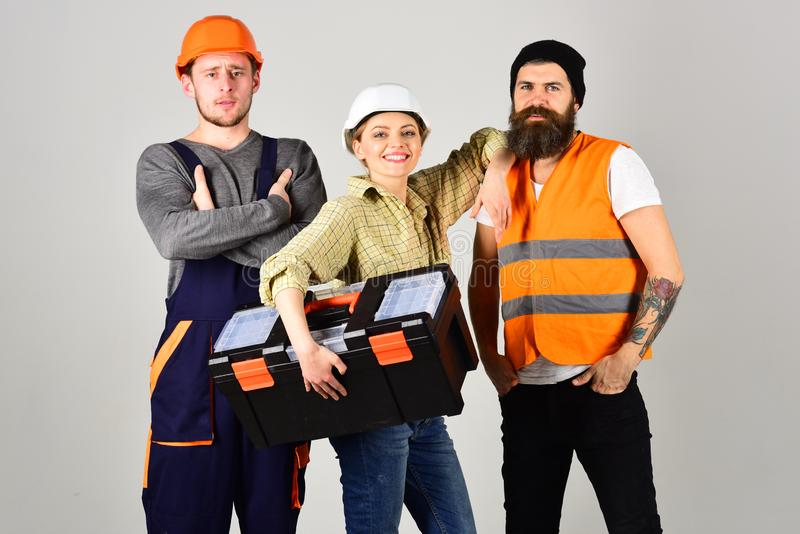 We are the great team. Construction workers team. Professional working team. Men and woman builders in workwear stock images