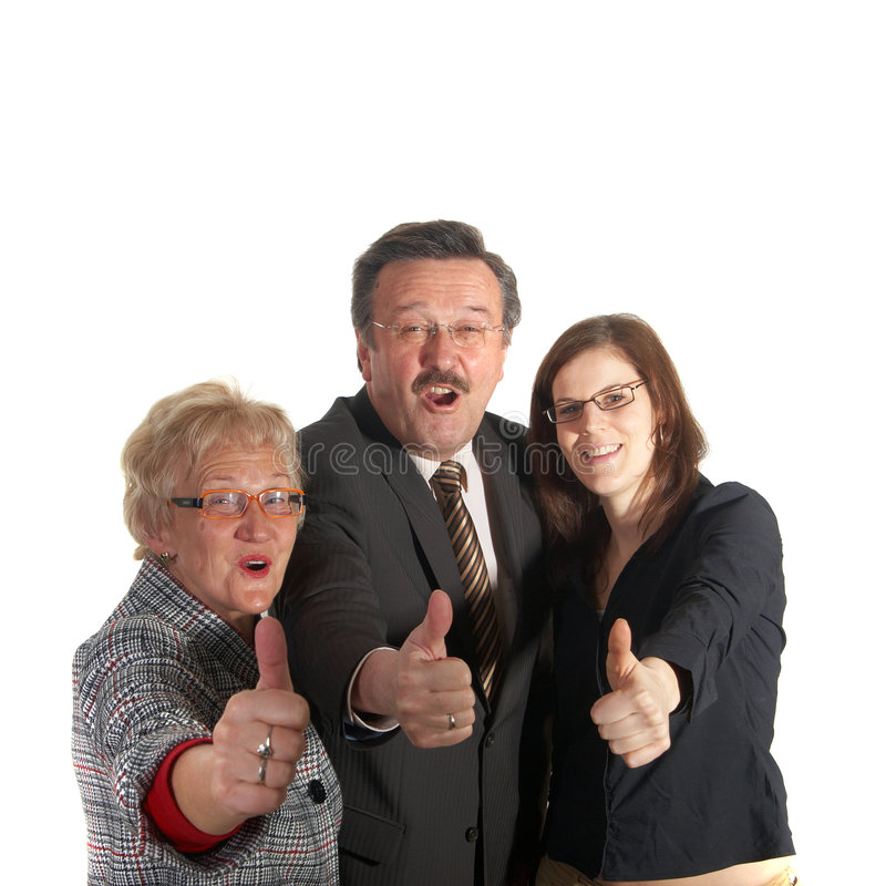 Great times. Senior business team with a young female worker giving thumbs up sign! They are all laughing hard stock photo