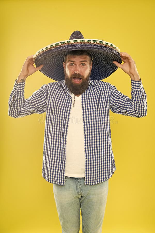 Great to top off his costume. Mexican man wearing sombrero. Traditional fashion accessory for mexican party. Bearded man. In mexican hat. Hipster in wide brim stock photography