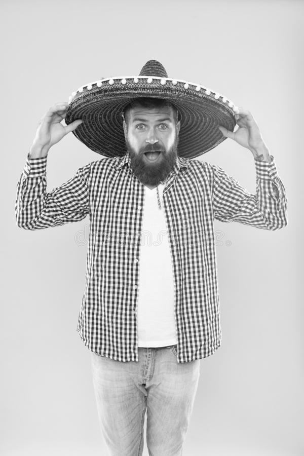 Great to top off his costume. Mexican man wearing sombrero. Traditional fashion accessory for mexican party. Bearded man stock photography