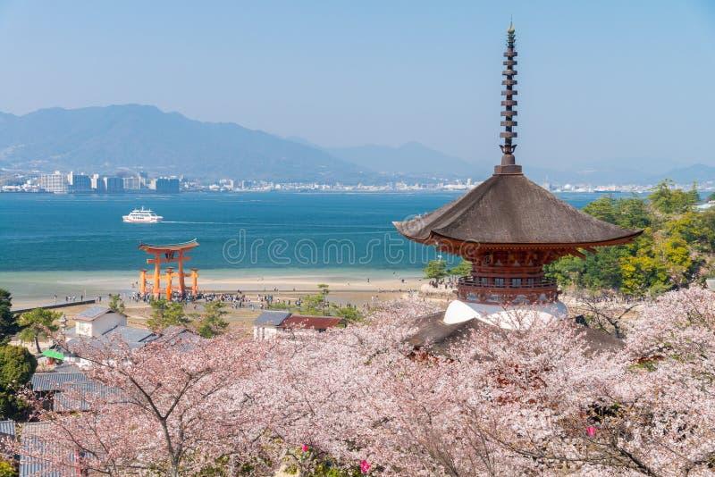 The Great Torii of Miyajima Island, Hiroshima, Japan from mountain view with ferry ship.  stock photos