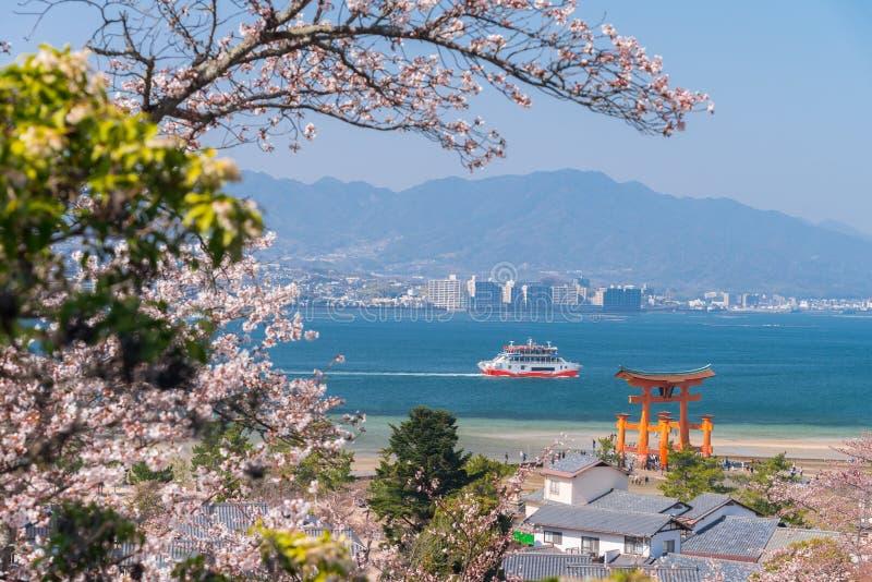 The Great Torii of Miyajima Island, Hiroshima, Japan from mountain view with ferry ship.  stock photography