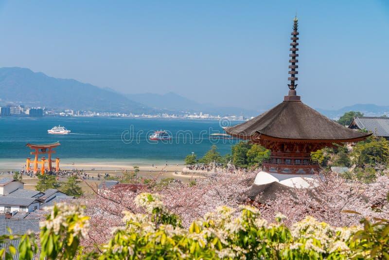 The Great Torii of Miyajima Island, Hiroshima, Japan from mountain view with ferry ship.  stock image